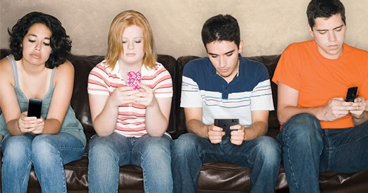 People being anti-social on the couch using their phones
